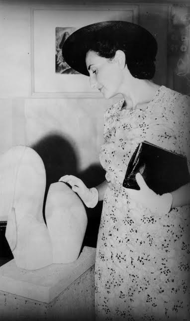 Viennese art critic Dr. Gertrude Langer inspecting a local art show, Brisbane, 1940
